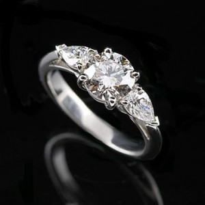 4. Pear Shaped Ring with Side Stones