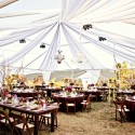 chandeliers-hanging-from-tent-outdoor-wedding-reception