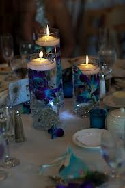 3. Floating Candles & Feathers Centerpiece