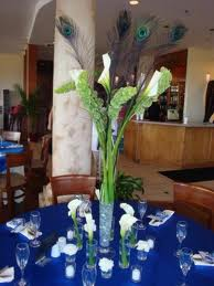 7.  A Simple And Different Peacock Feather Centerpiece