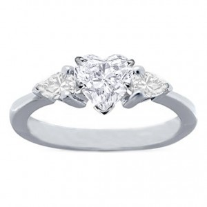 7. Heart Set Pear Engagement Ring